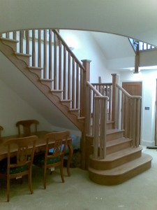 This was a really nice oak staircase to do.  It was for an impressive new build house in West Byfleet, and the client had the build planned out very well, which always helps in acheiving the desired result.  This was in fact 2 two staircases as the house has three floors, the flight shown to the left was from the ground floor, leading up to the first floor. You can just see the second staircase directly above this one which leads upto the second floor. The double bullnose and twin monkey-tail handrails really make for a spectacular entrance through the front door into the main hallway.
