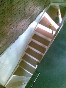 Double winding staircase in softwood & MDF