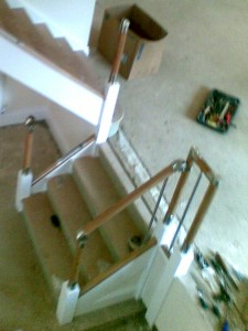The oak and chrome handrail, newels and spindles are fitted