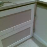 Two drawer fronts per drawer breaks up the large size of the filing drawers to make them look more proportional