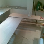 "First ""L"" shaped section of oak-faced MDF being fitted"