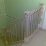 Handrail, baserail, spindles and newel caps fitted